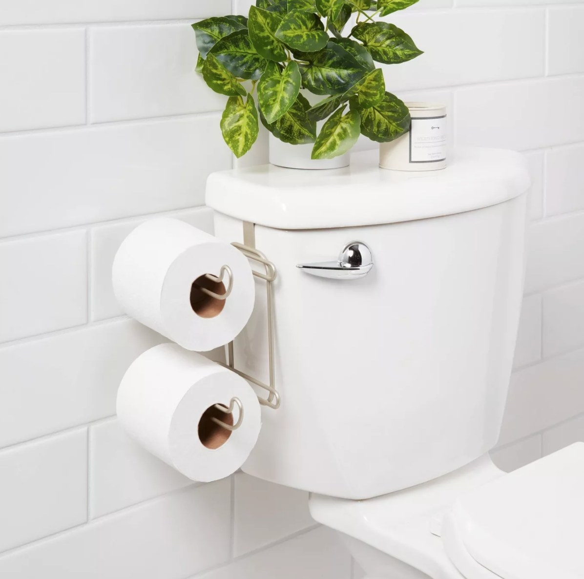 A metal toilet roll holder that hangs from the toilet