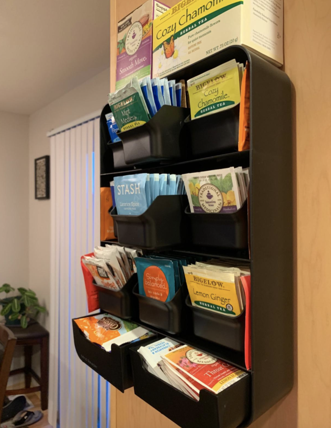 Review image of organizer attached to the wall with nine drawers for holding tea bags