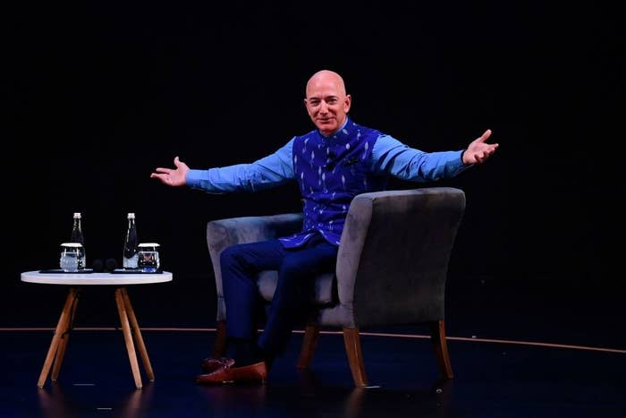 Jeff Bezos on a couch with his arms open