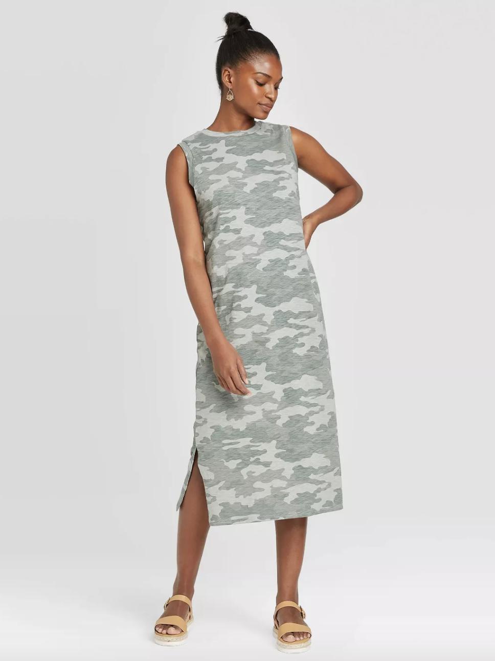 model wearing camouflage dress