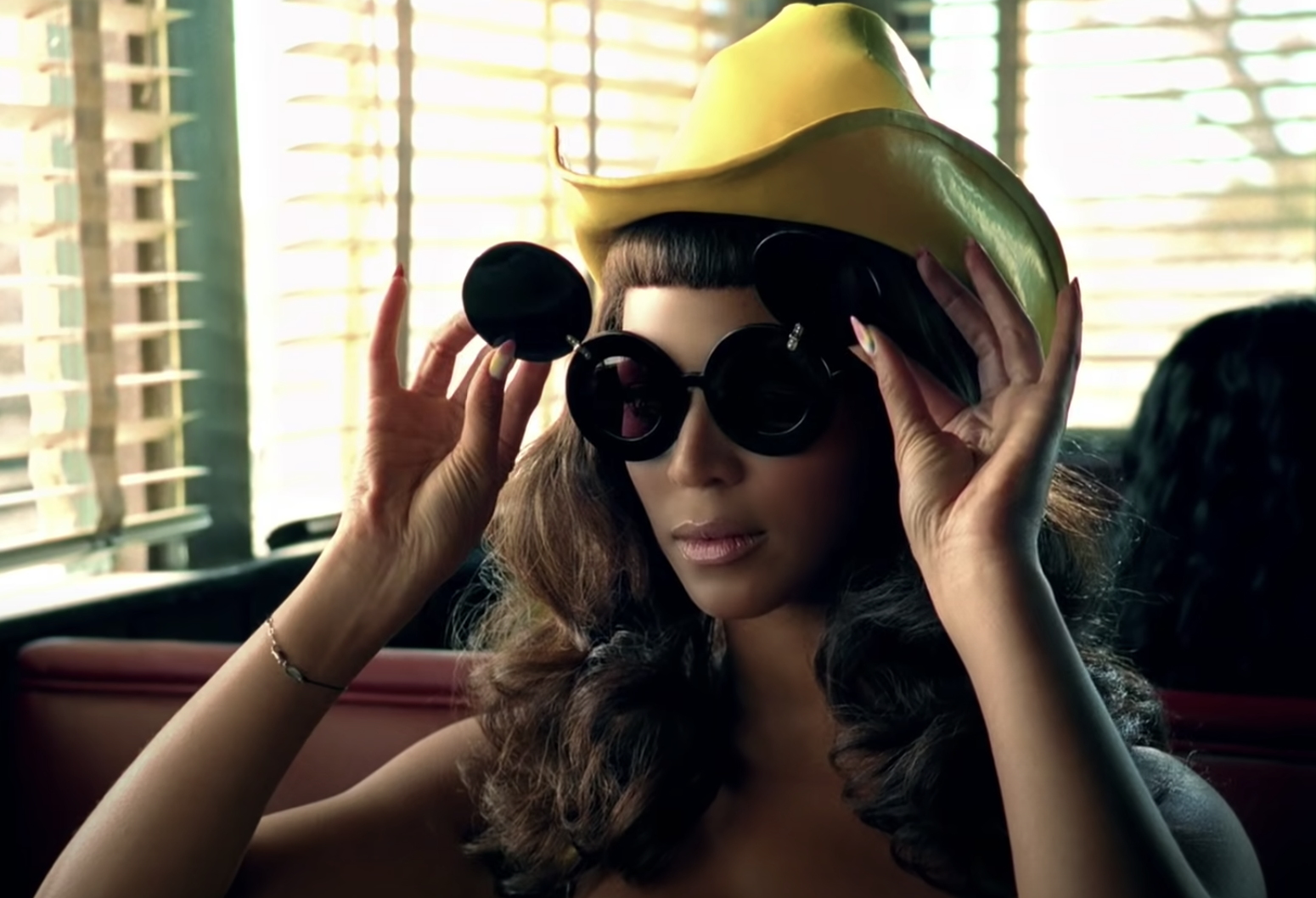 Beyoncé flipping her Mickey Mouse–esque sunglasses up after she successfully killed her man