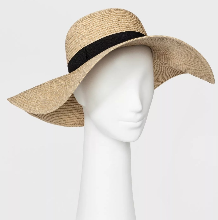 a floppy tan sun hat on a mannequin