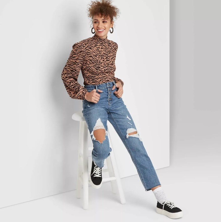 a model posing in the ripped jeans
