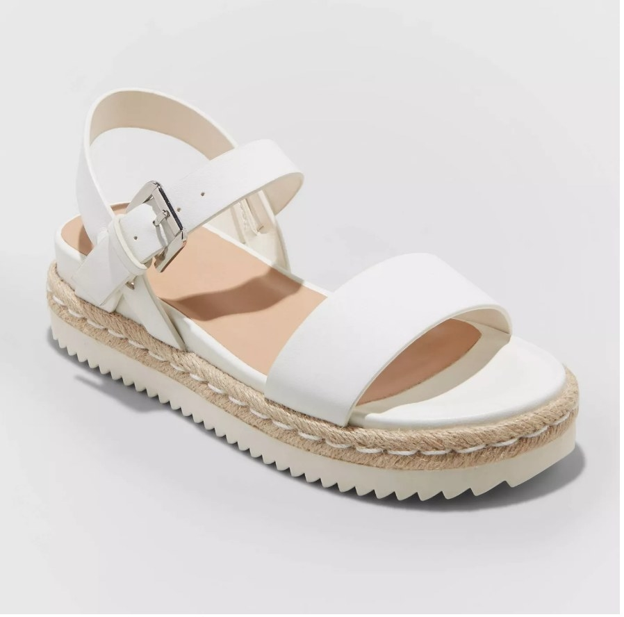 sandals with a white ribbed bottom, tan woven rope a layer above that, and white straps