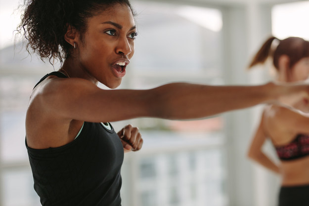 Woman saying something as she is working out