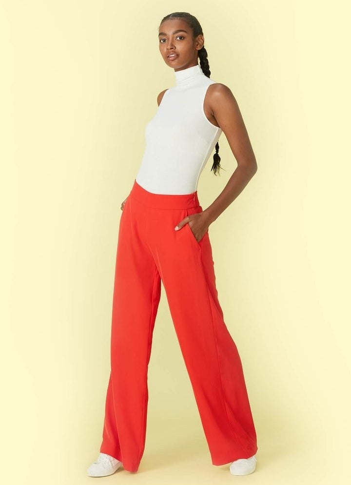 model in red wide-legged pants with elastic waist