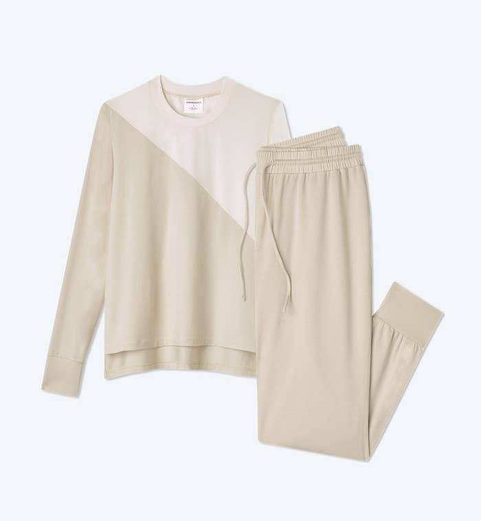 beige joggers and matching beige pullover with a diagonal color block of cream