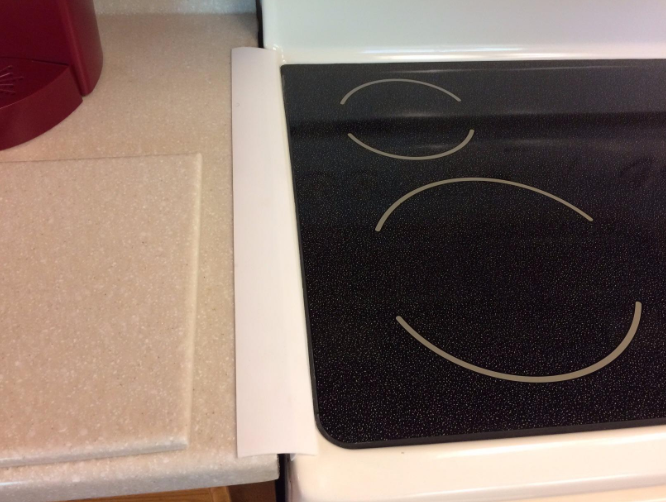 A reviewer's kitchen showing the gap between the counter and the oven covered with the product