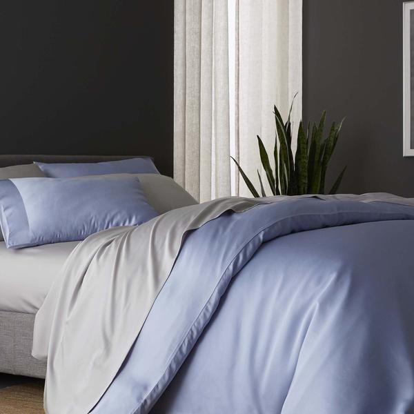 bed with blue and gray sheets