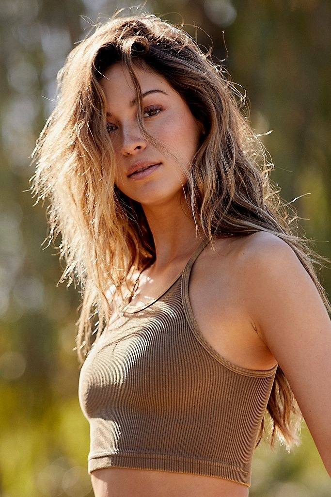 model wearing brown ribbed crop top with spaghetti straps