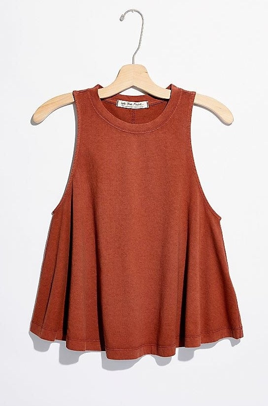 rust orange tank with large arm holes that's wider at the bottom