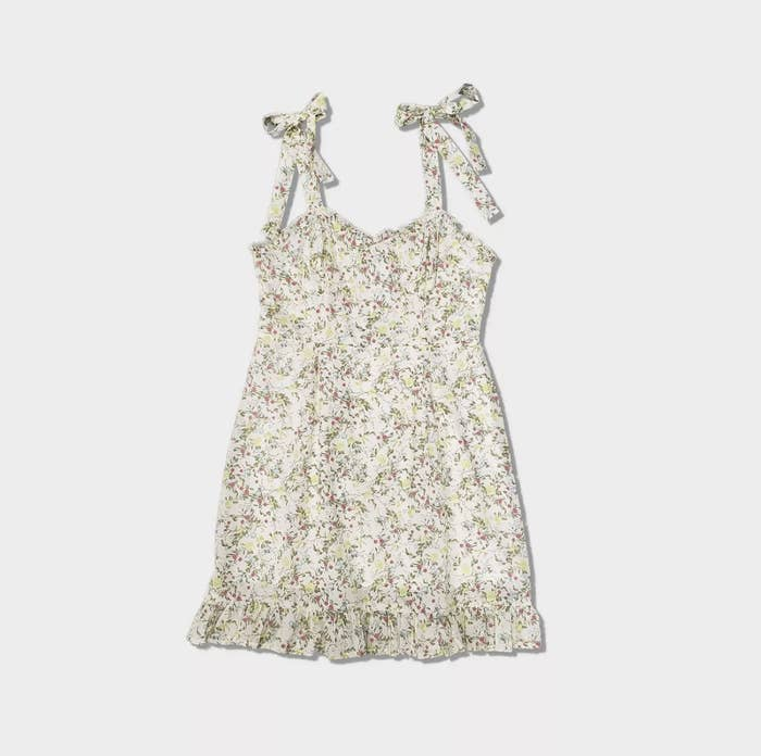 an off-dress with tied straps covered in tiny florals