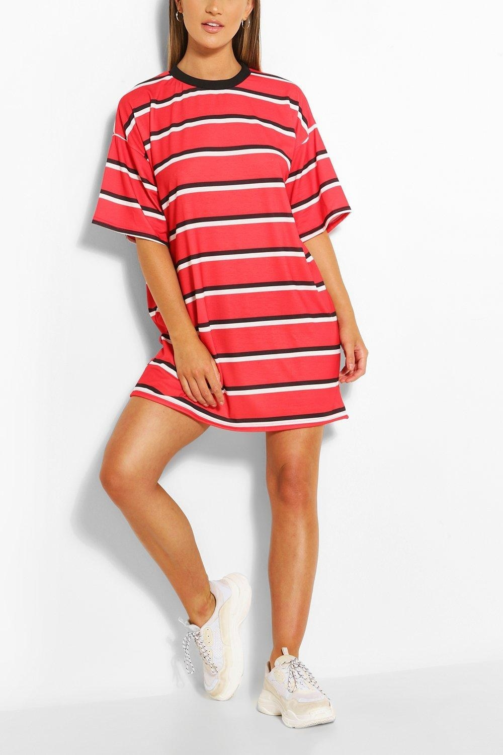model in red, black, and white oversized tee dress