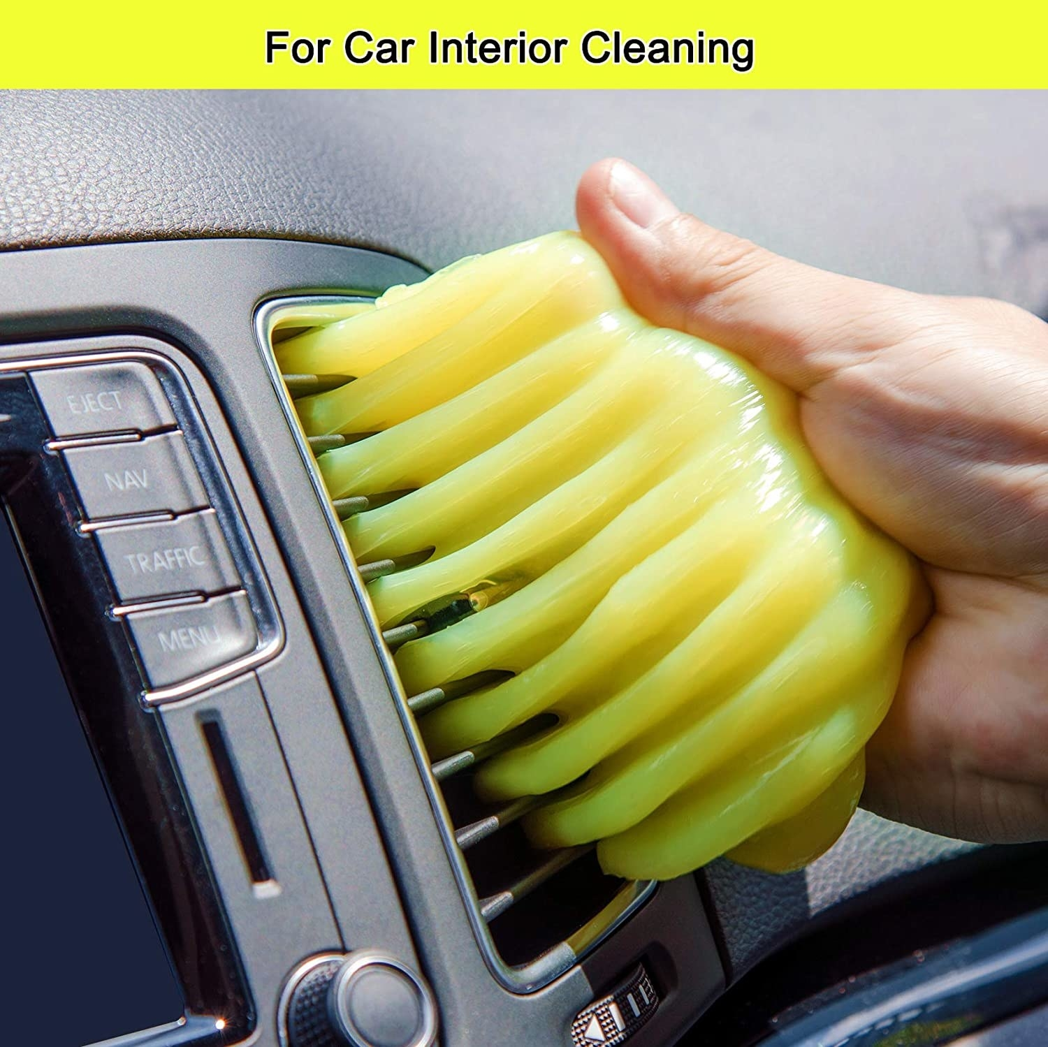 Hand pressing the cleaning gel into a car's AC vent