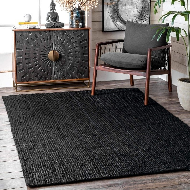 The black jute rug in a living space