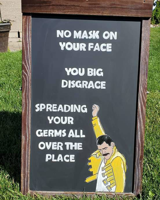 Sign reading no mask on your face you big disgrace spreading your germs all over the place