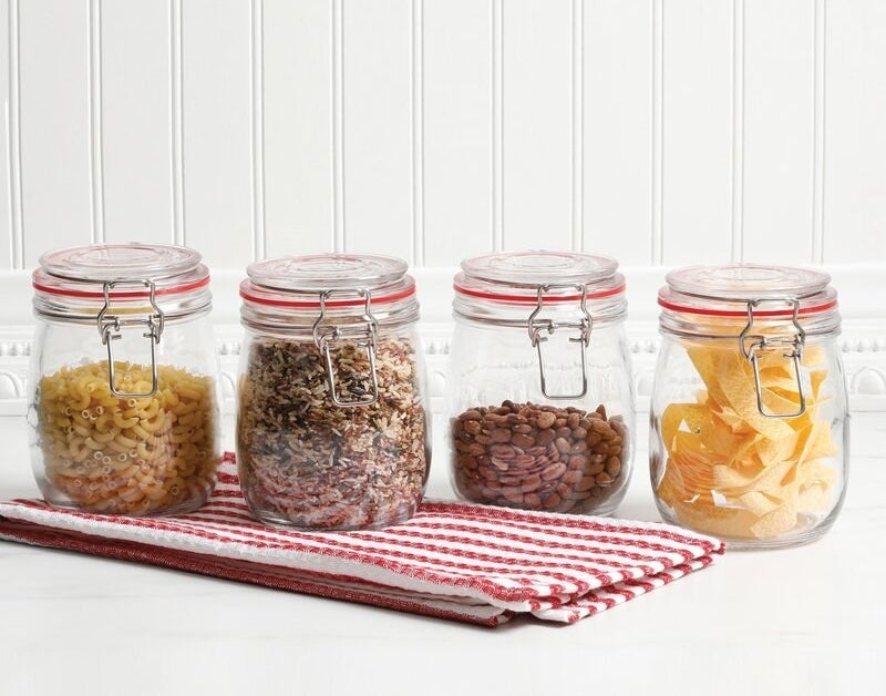 The four glass jars on a surface