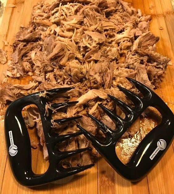 Reviewer's picture of the claws with a pile of pulled pork