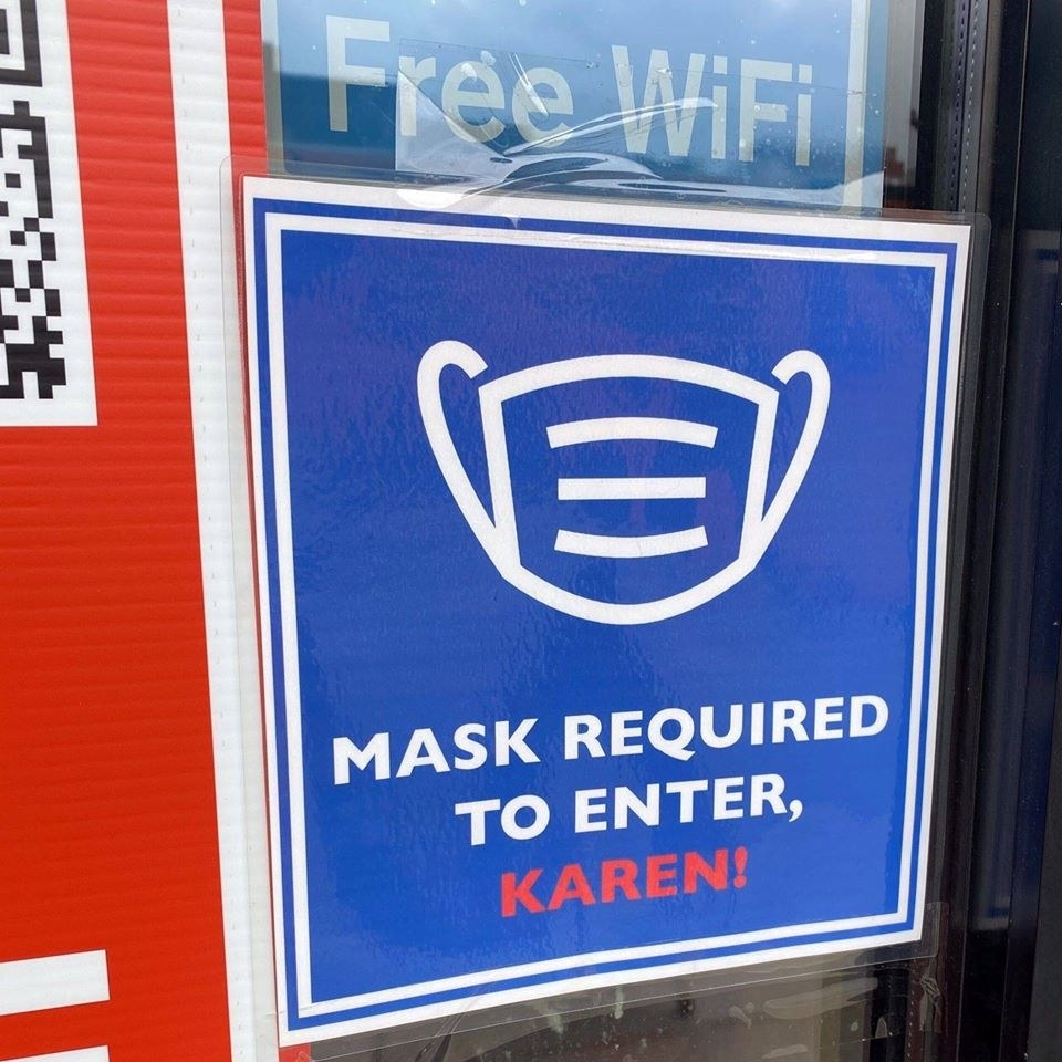 Sign reading mask required to enter, karen