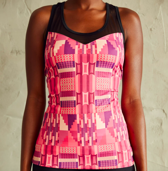 Model wears pink printed sweetheart tank top with black workout leggings