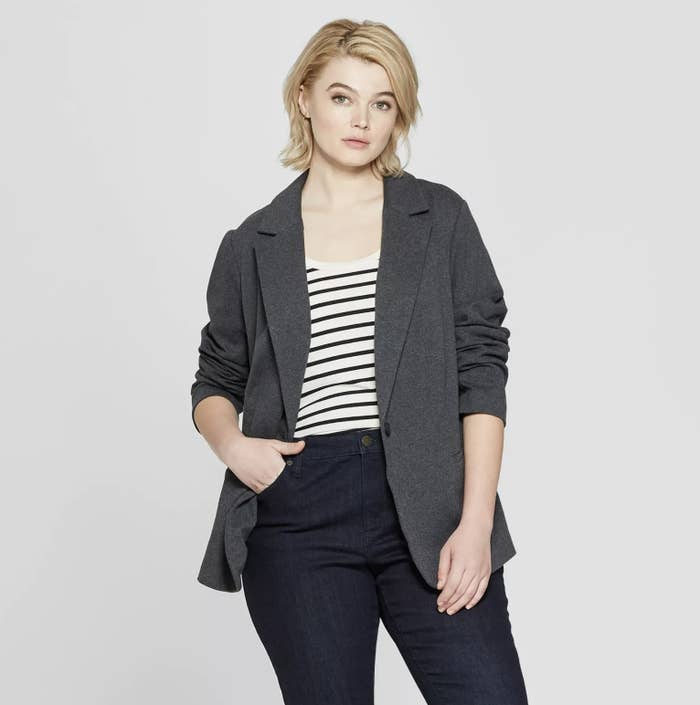 model wearing gray blazer