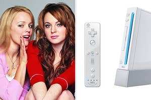 Regina George whispering into Cady Heron's ear, next to a Wii