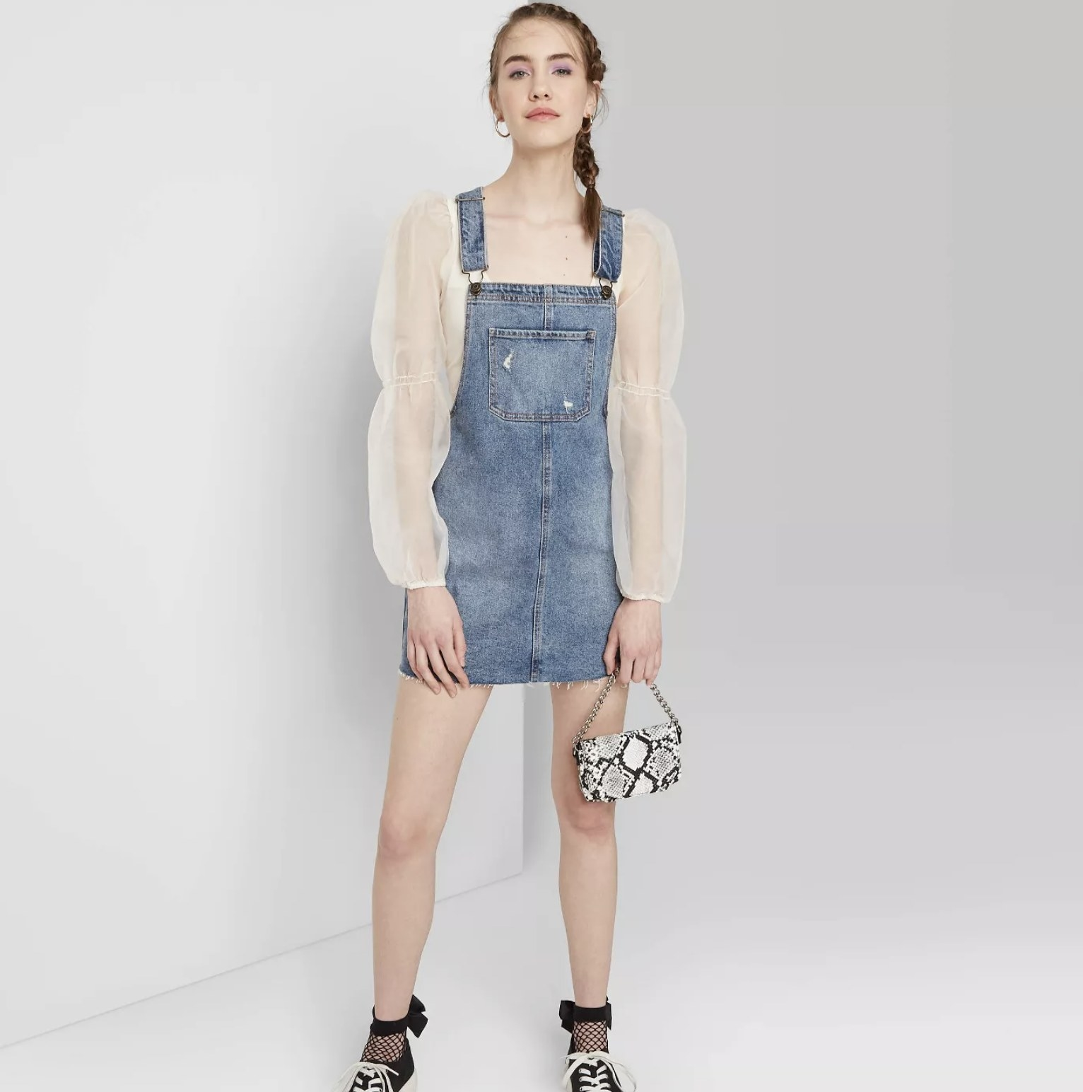 model wearing denim mini dress