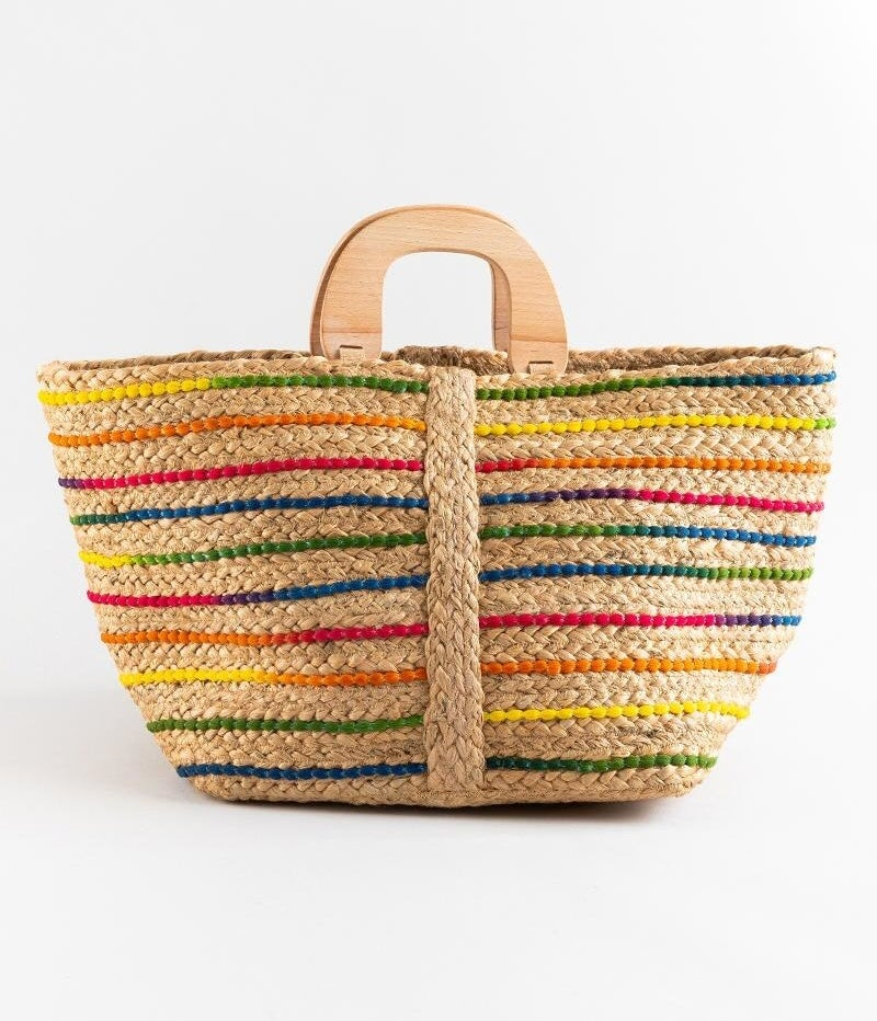 The large tote with wooden handles and different color stripes woven into it
