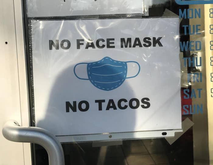 Sign reading No face mask no tacos