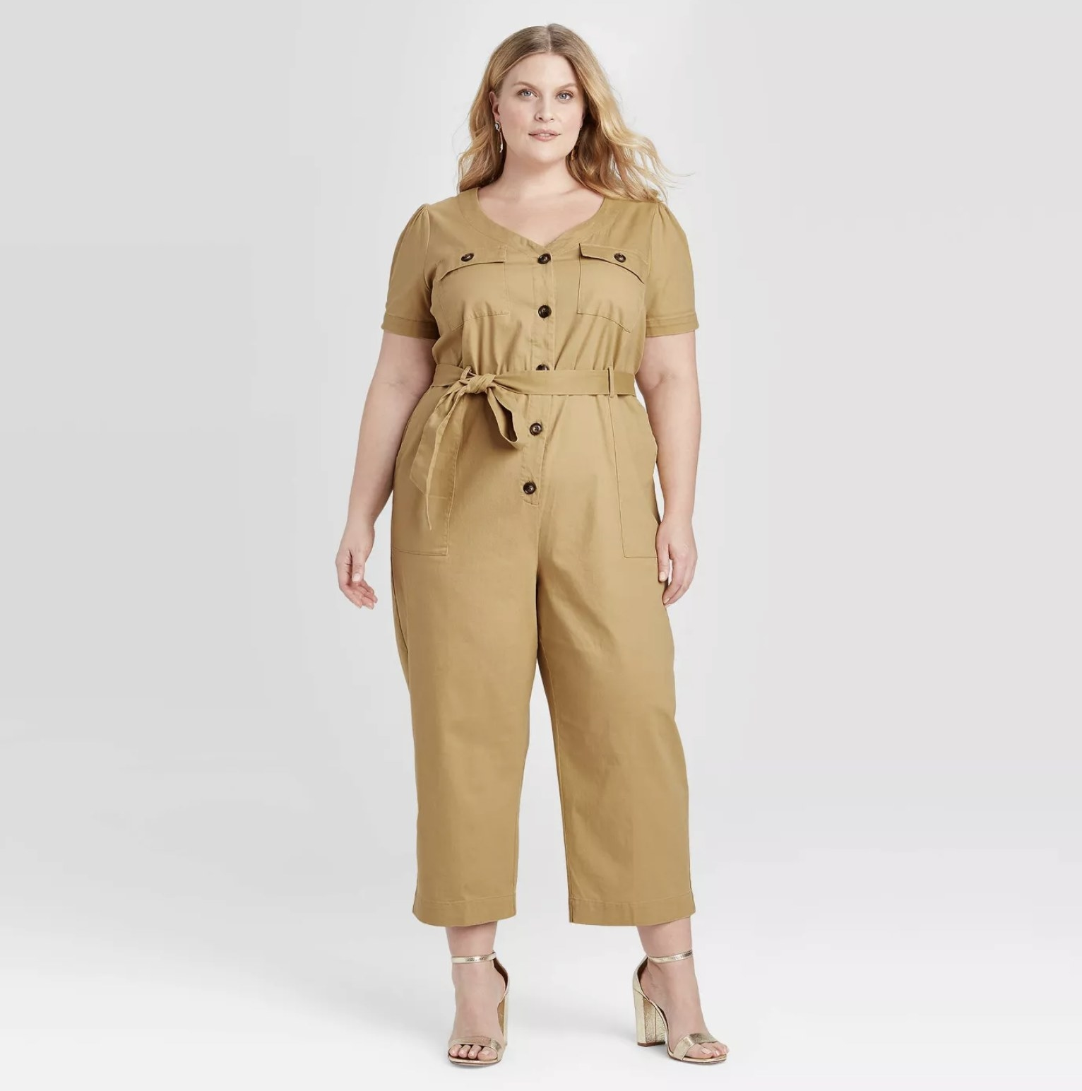 model wearing tie waist, button-up utility jumpsuit