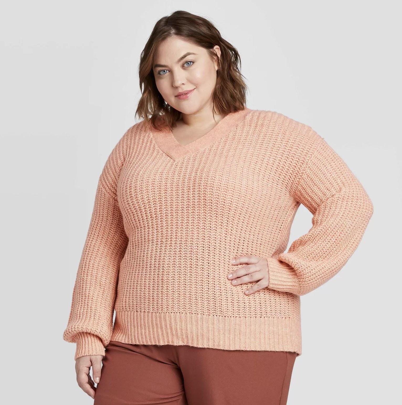 model wearing light pink V-neck sweater
