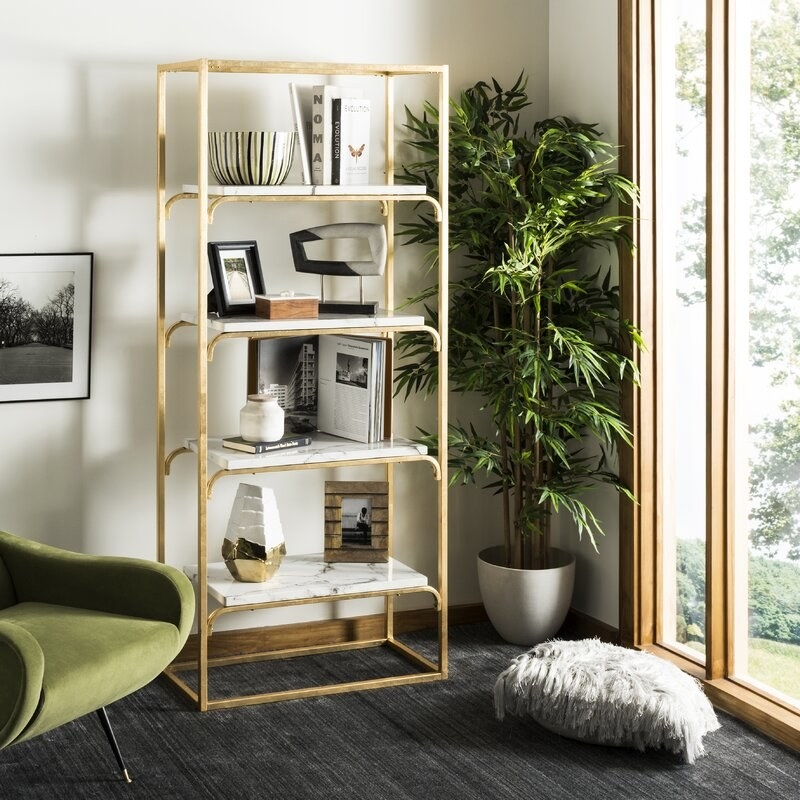 The four-shelf bookcase with a hollow gold frame