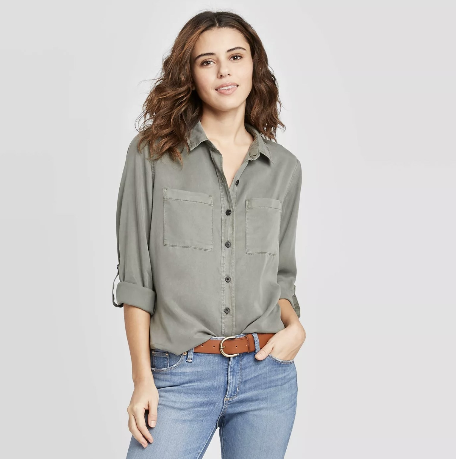 model wearing olive green button-up shirt