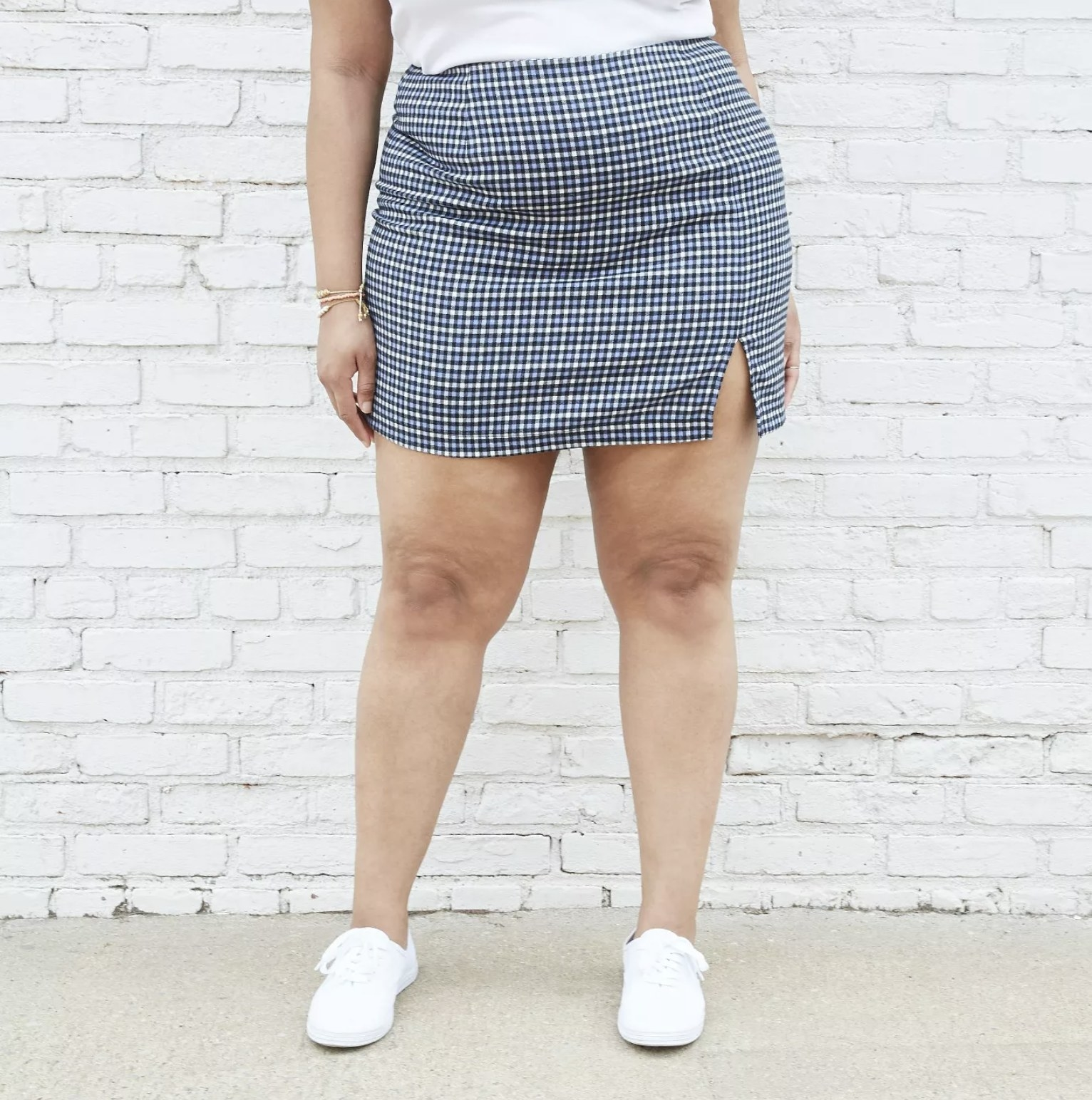 model wearing blue and white plaid mini skirt