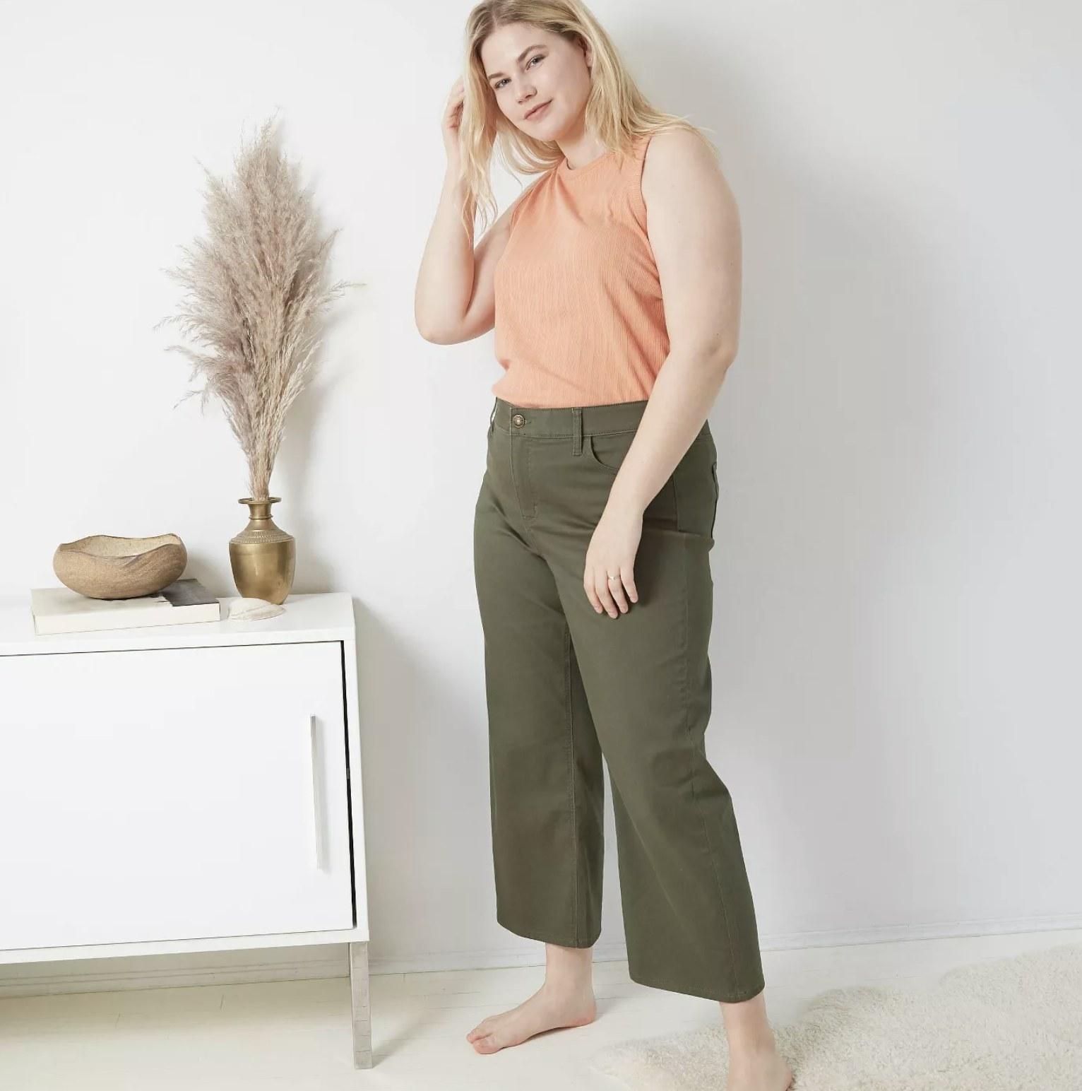 model wearing olive green wide leg pants