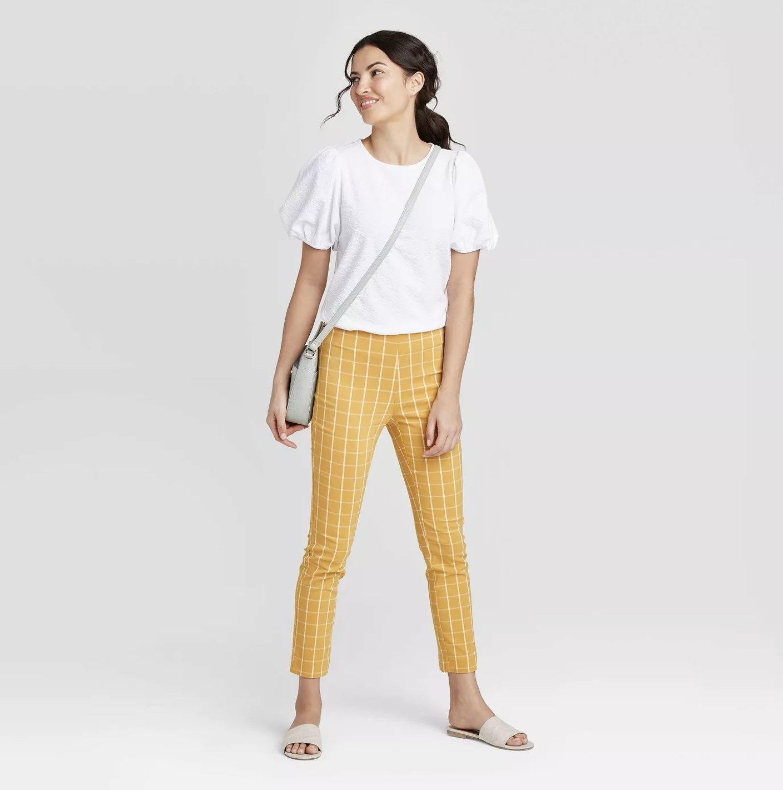 model wearing yellow and white plaid pants