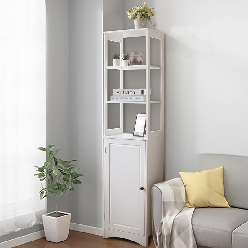 A linen cabinet with three open tiers at the top and a two additional shelves enclosed with a door at the bottom. It's white.