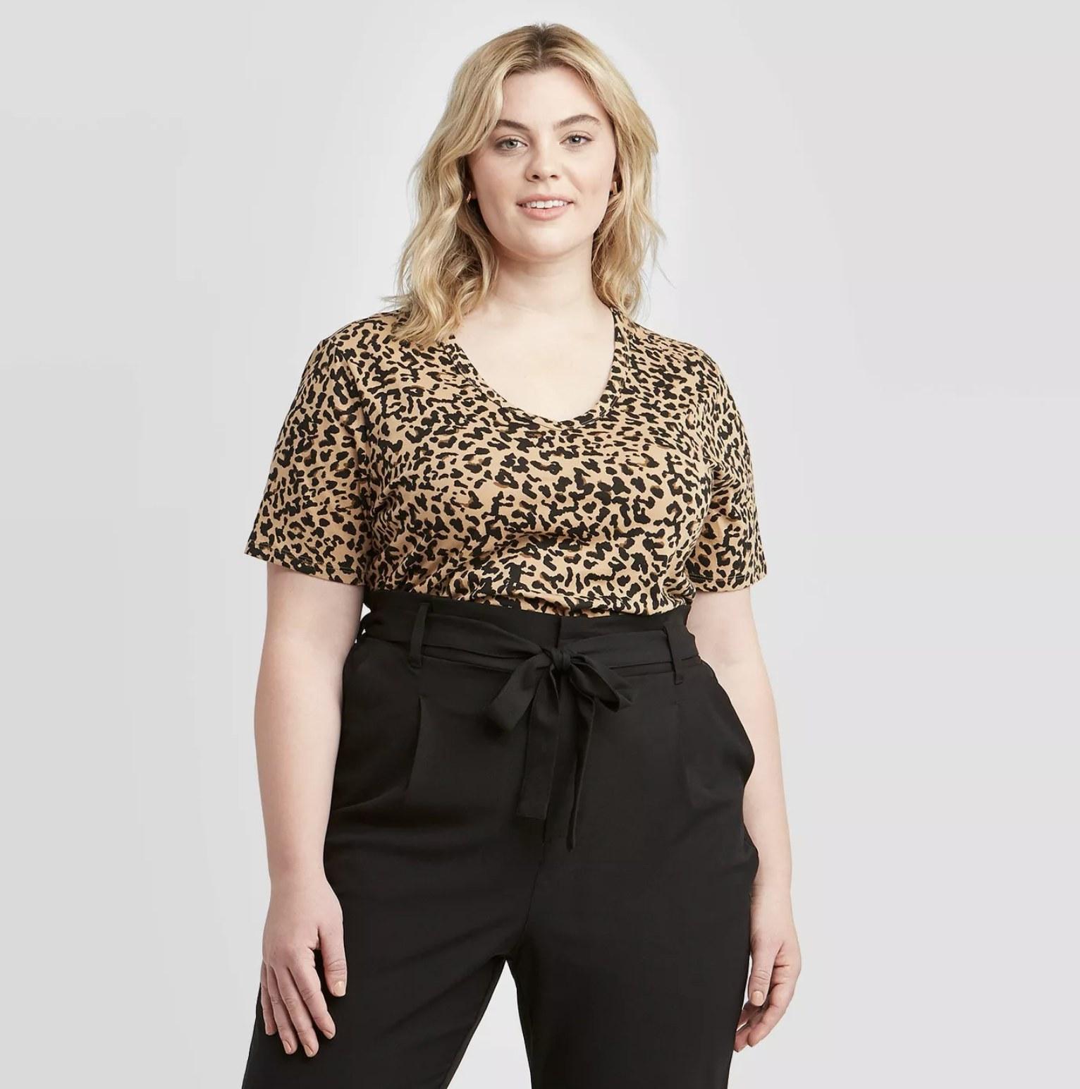 model wearing V-neck leopard tee