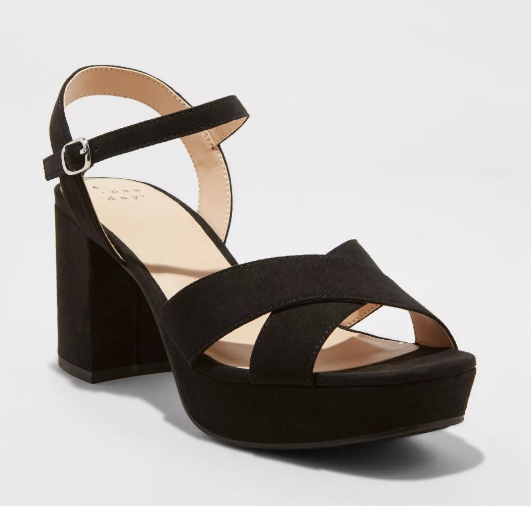 black block heels with a think ankle stap and cross cross toe straps