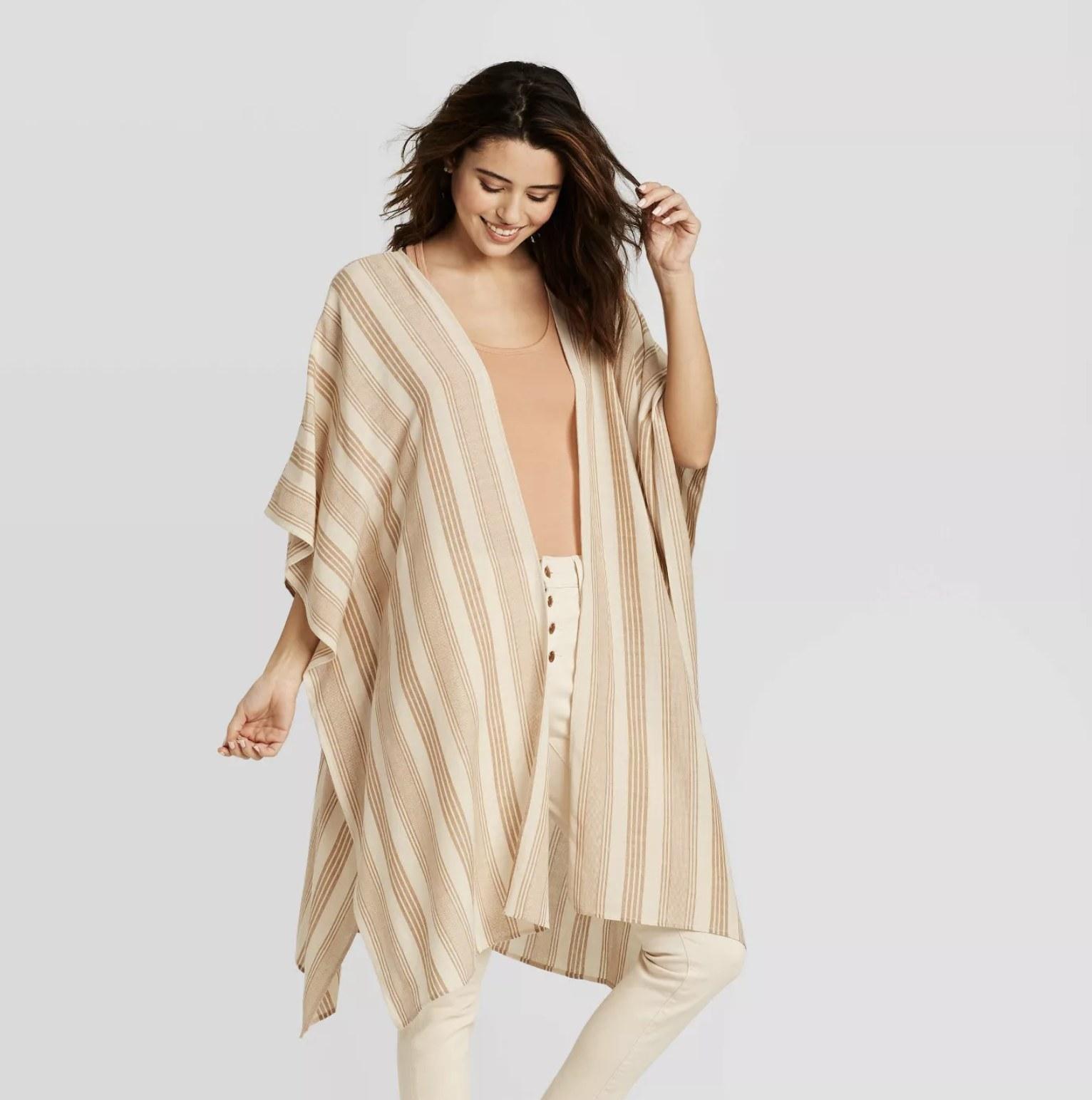 model wearing midi length striped kimono