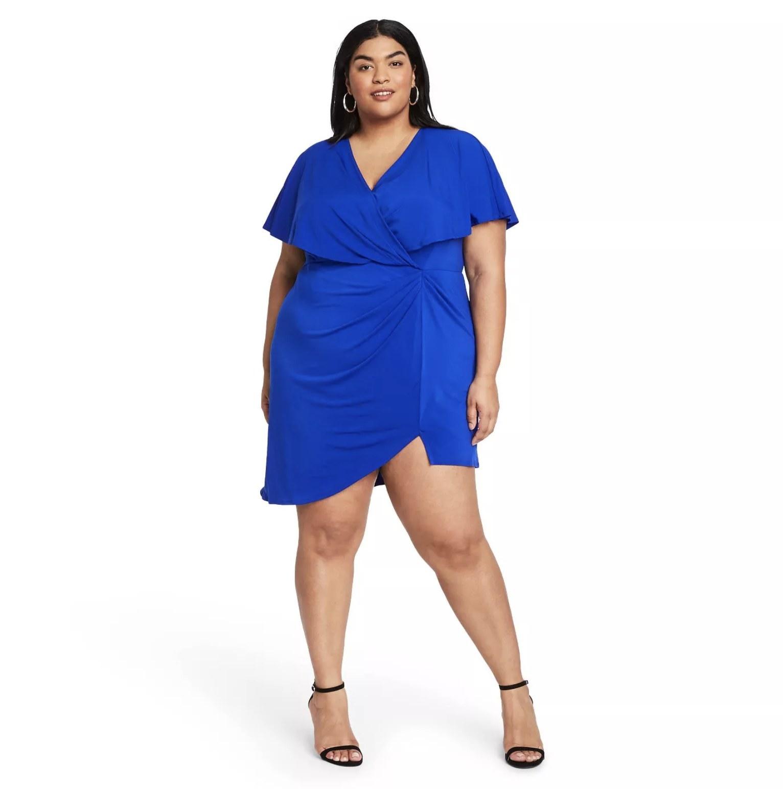 model wearing royal blue V-neck mini dress