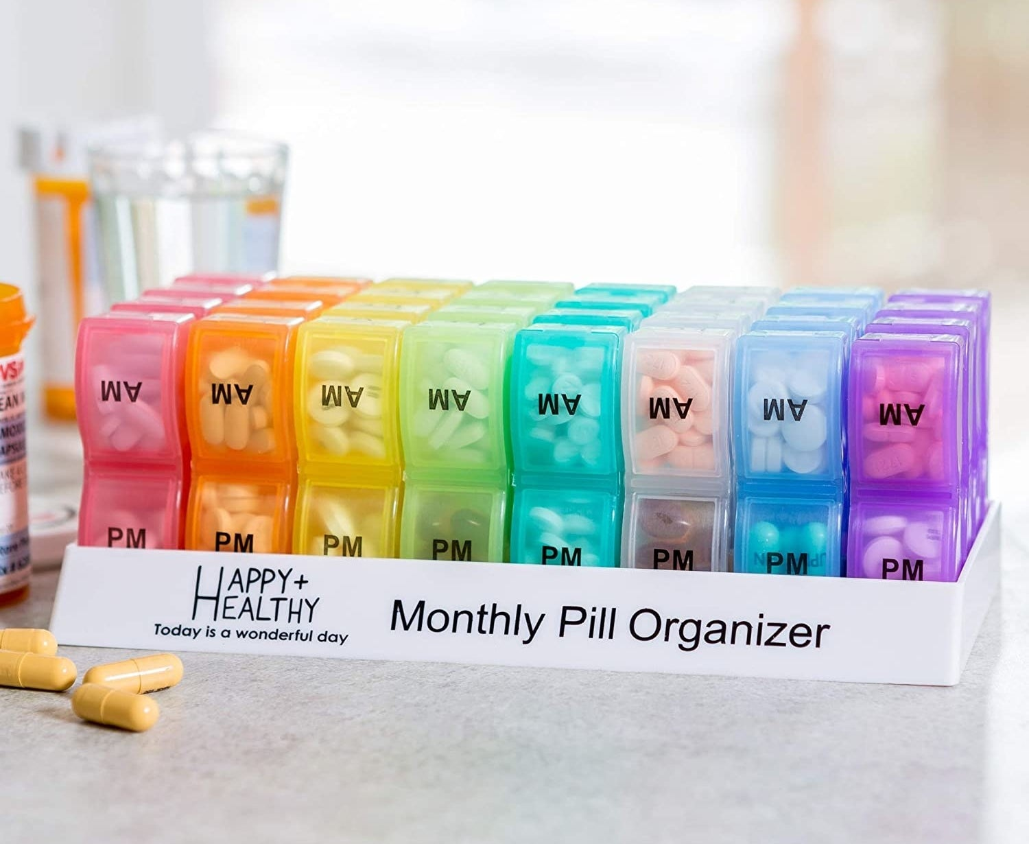 The monthly pill organizer filled with capsules