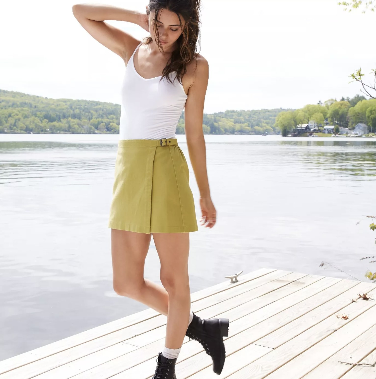 model wearing yellow wrap mini skirt