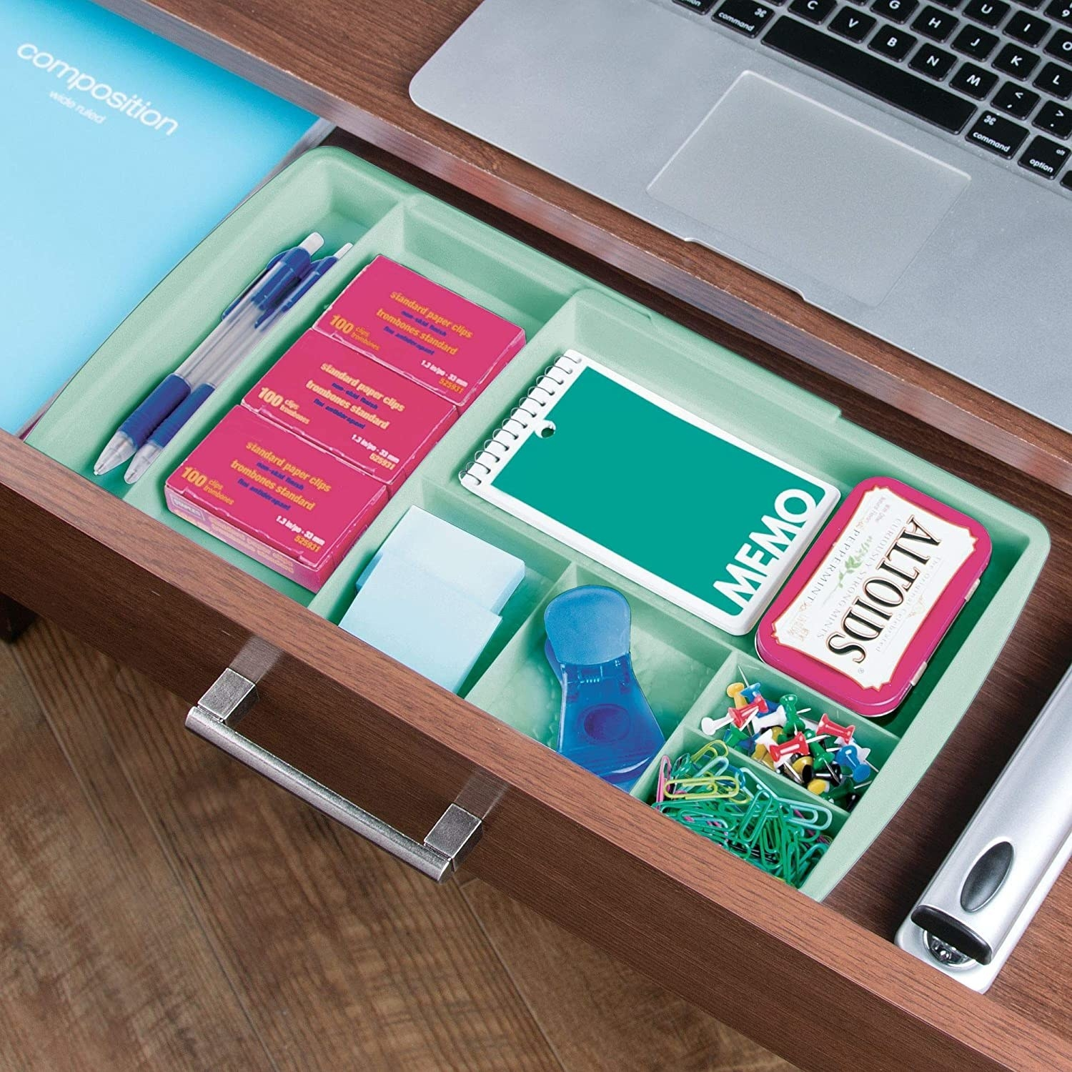A desk organizer stocked with thumbtacks, paperclips, sticky notes, breath mints, and more