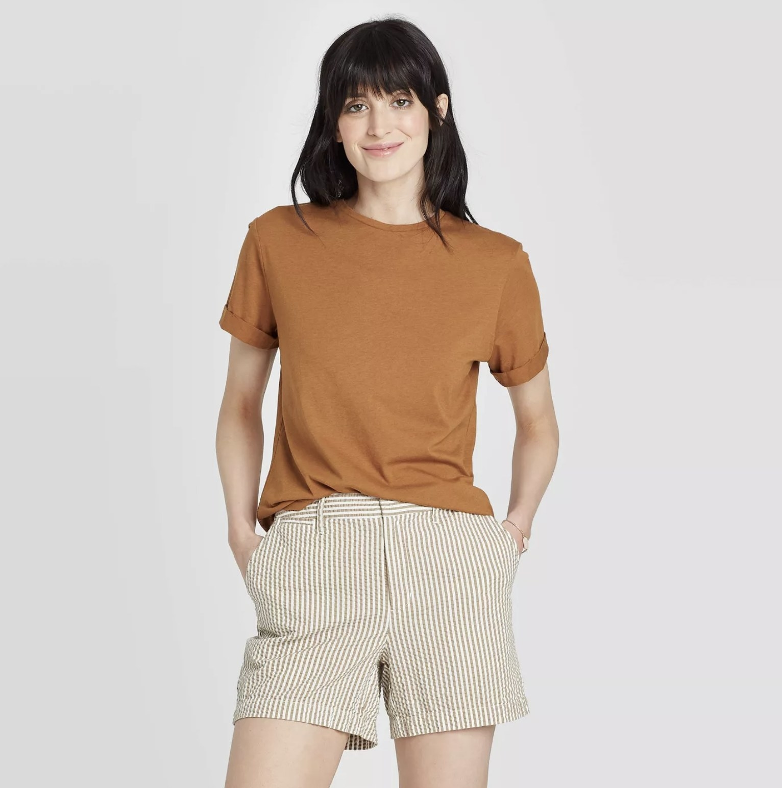 model wearing rust-colored shirt