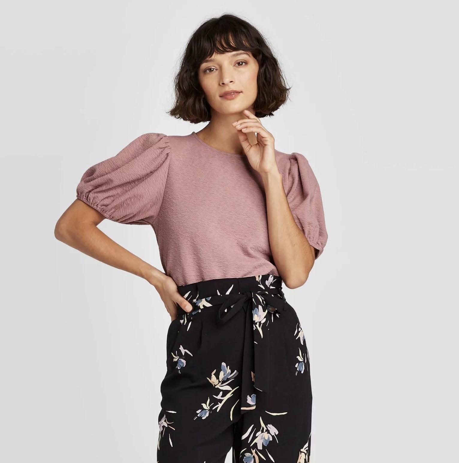 model wearing pink puff sleeve shirt