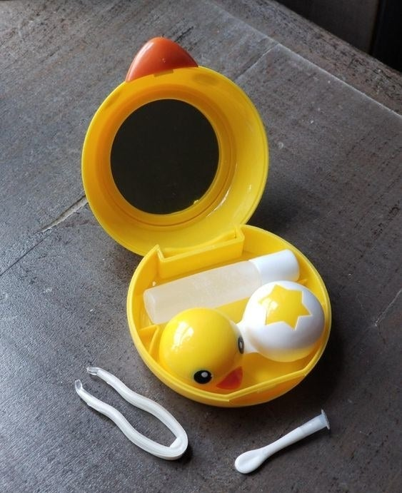 Reviewer's picture of the chick-themed contact lens travel case