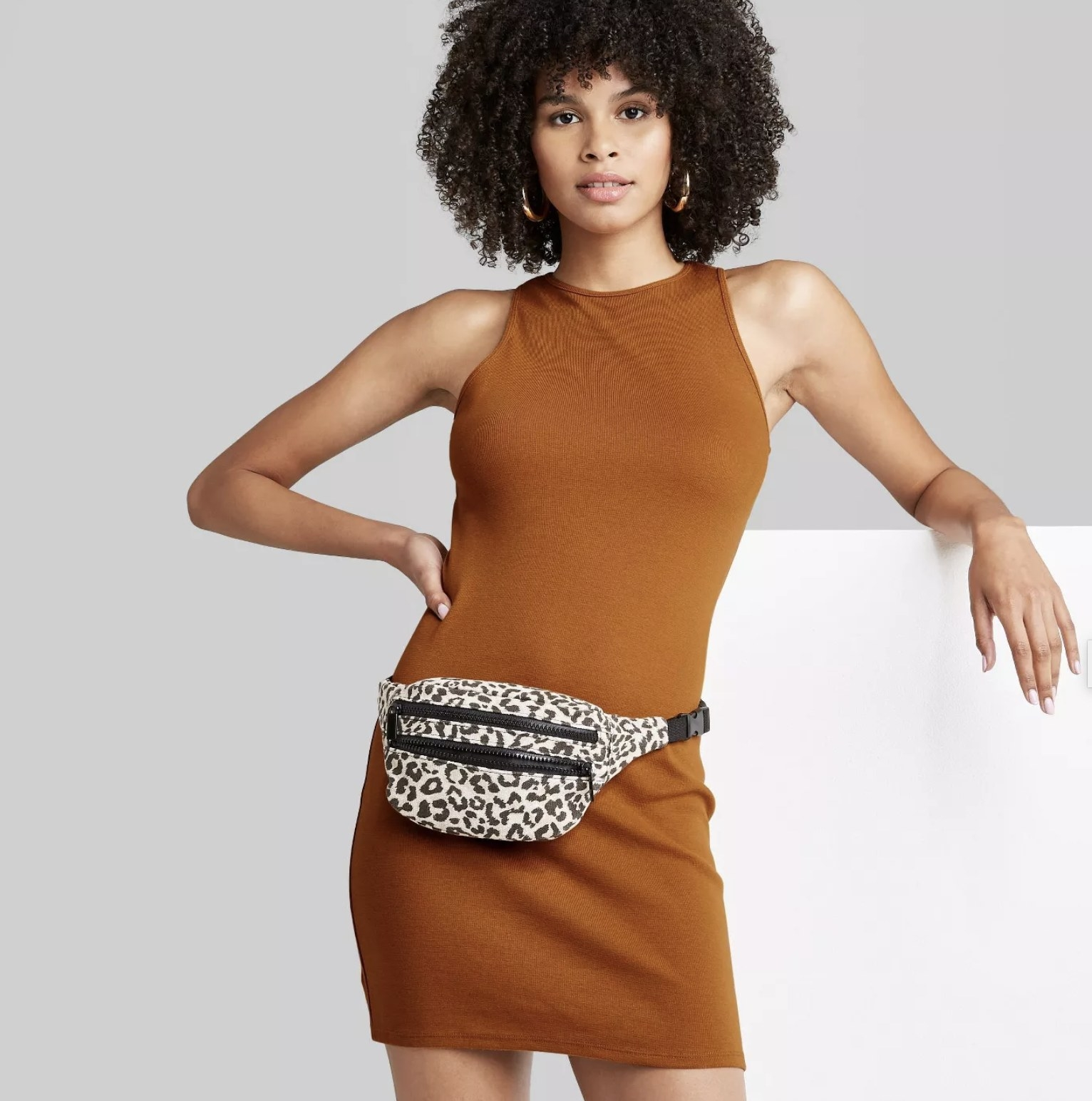 model wearing dark orange mini dress
