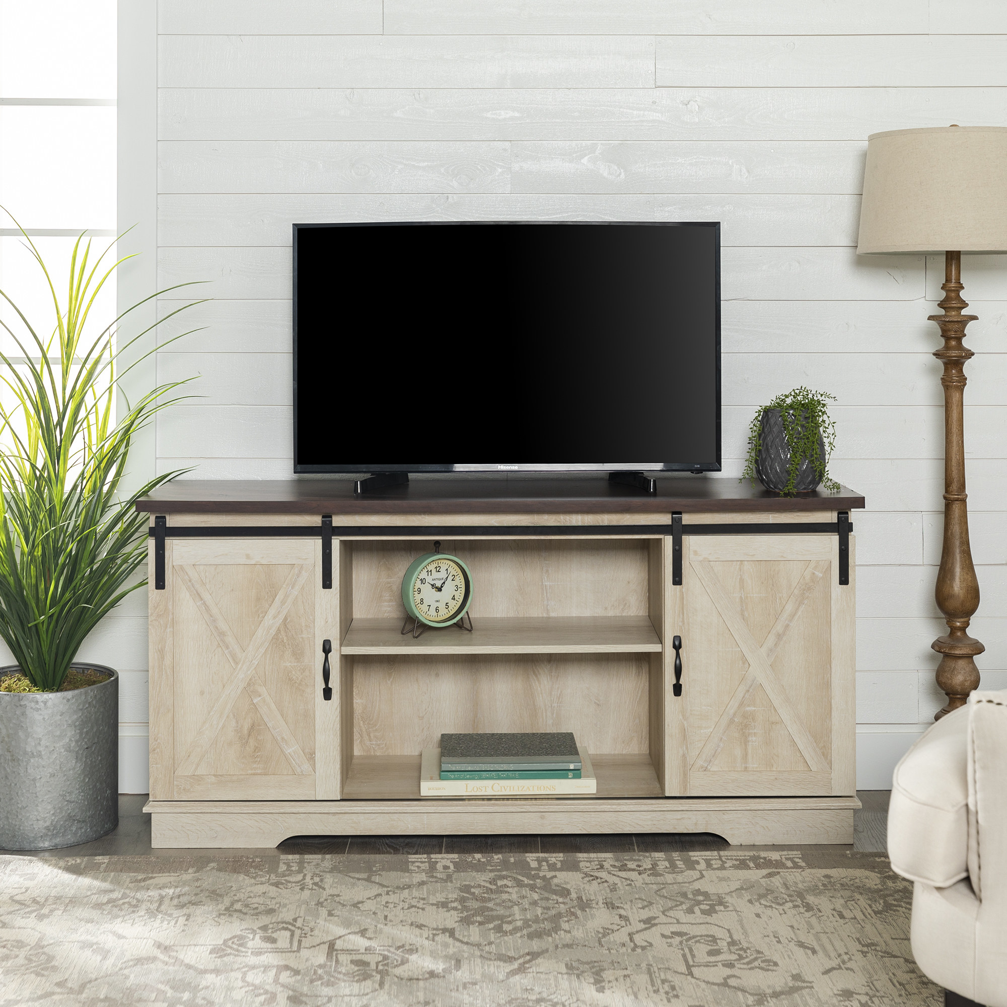A brown and white oak televisions stand with two cabinets and shelf space in the middle