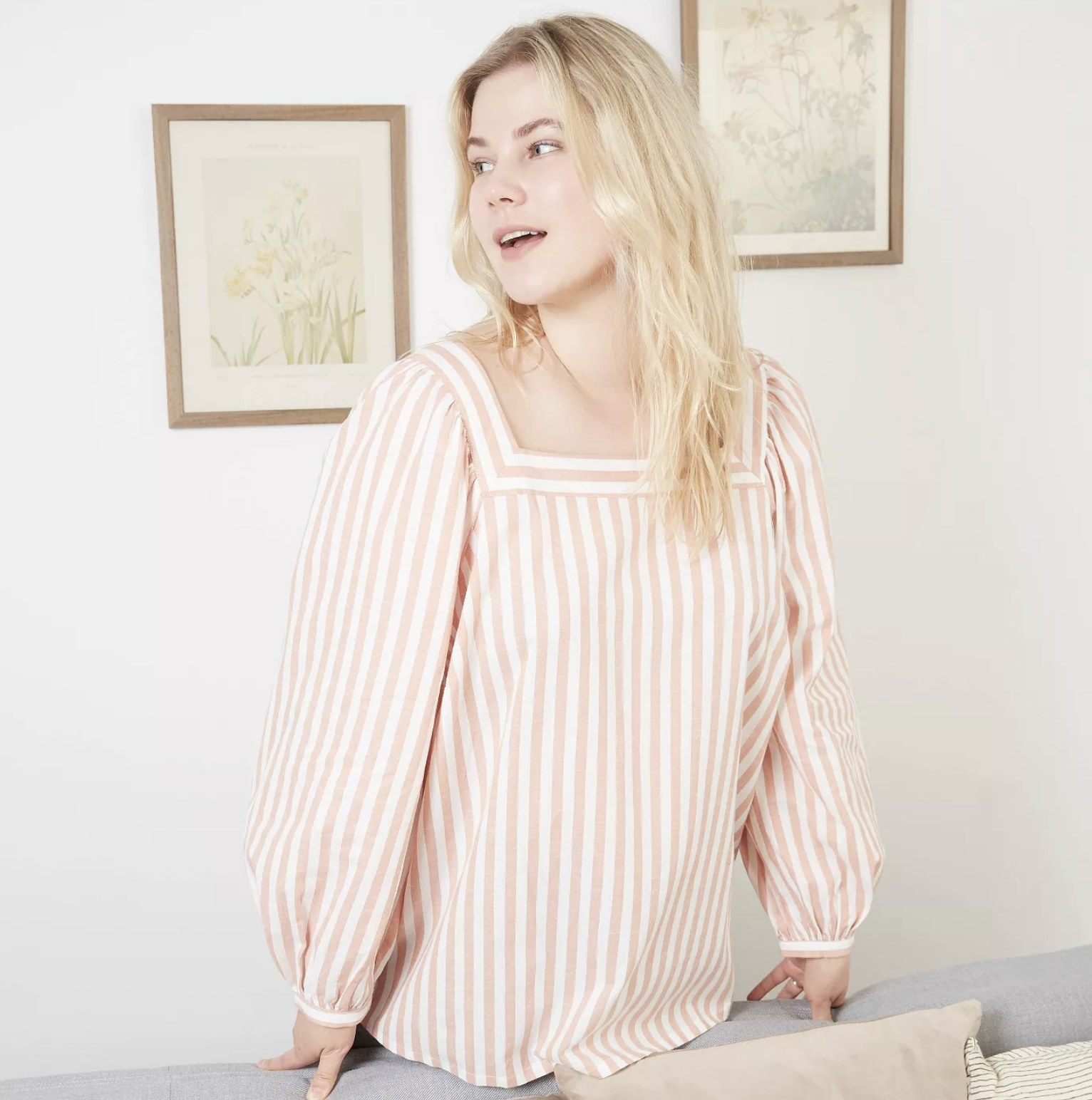 model wearing pink and white striped blouse